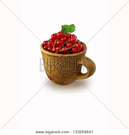Red currant in clay cup isolated on white
