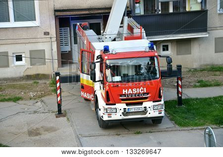 Bytca, Slovakia - June 4, 2016: Iveco Eurocargo fire truck in action some house in background.