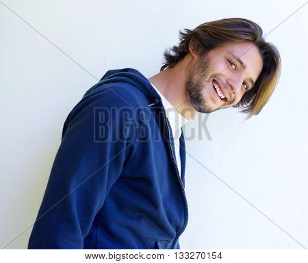 Attractive Young Man Smiling Against White Wall