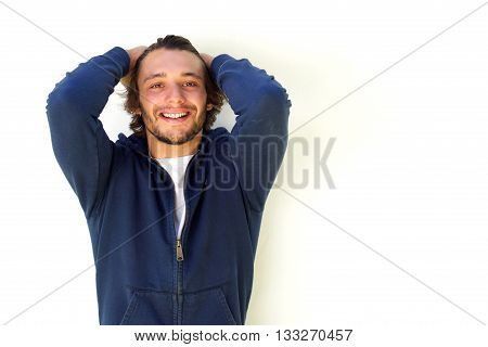 Smiling Young Man With Hands In Hair