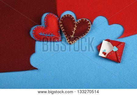 Felt Craft And Art Two Hearts Cut Out On Blue