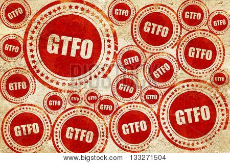 gtfo internet slang, red stamp on a grunge paper texture