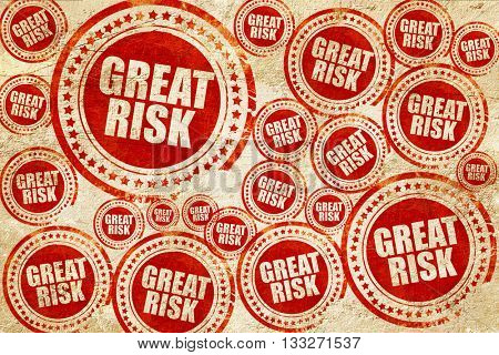 great risk, red stamp on a grunge paper texture