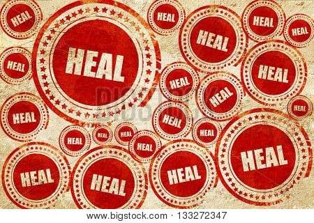 heal, red stamp on a grunge paper texture