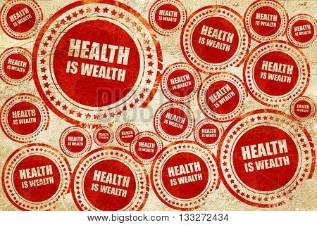 health is wealth, red stamp on a grunge paper texture