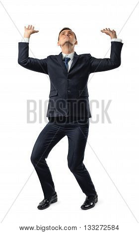 Full length of cut-out businessman pushing invisible wall under pressure. Conceptual photo. Problems and issues. Business staff. Office clothes. Dress code. Presentable appearance.