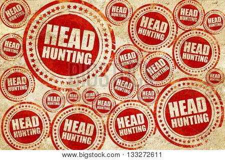headhunting, red stamp on a grunge paper texture