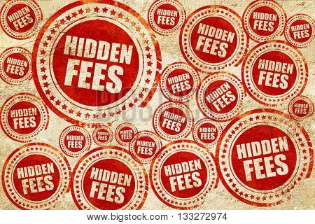 hidden fees, red stamp on a grunge paper texture