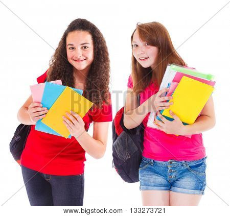 Two smiling teenage students with books