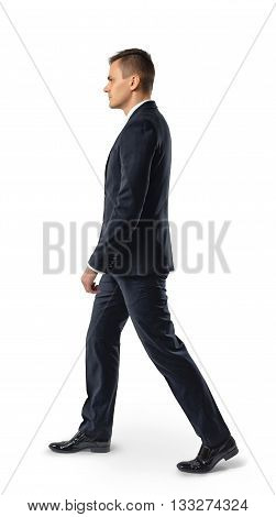 Side view of businessman walk, isolated on white background. Successful lifestyle. Business staff. Office clothes. Dress code. Presentable appearance. Self-confidence.