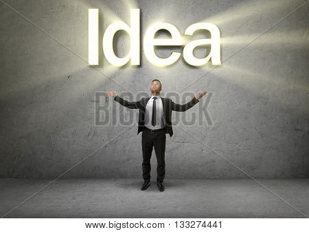Businessman raised his hands up to emphasize the Idea. Formation of ideas. Business concept. Inspiration. Process of thinking.
