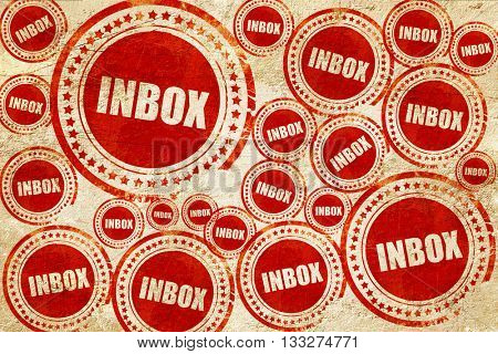 inbox, red stamp on a grunge paper texture