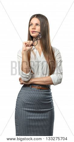 Cutout businesswoman stands with folded arms looking up. Thinking process. The emergence of new ideas. Success and development. Business staff. Office clothes. Dress code. Presentable appearance. Successful lifestyle.
