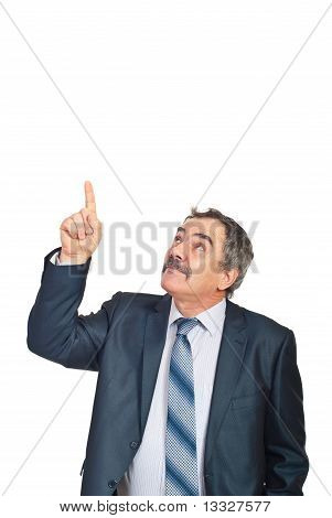 Mature Executive Pointing Upwards To Copy