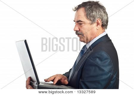 Mature Business Man Type On Laptop
