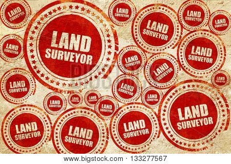 land surveyor, red stamp on a grunge paper texture