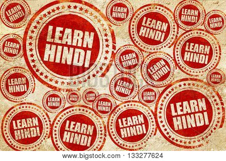 learn hindi, red stamp on a grunge paper texture