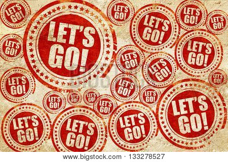 let's go!, red stamp on a grunge paper texture