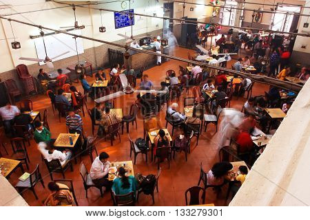 KOLKATA, INDIA - JAN 18, 2013: Visitors of popular Indian Coffee House have lunch on January 18, 2013 in India. The India Coffee House chain was started by the Coffee Cess Committee in 1936 in Bombay