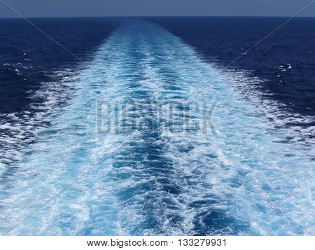 Wake from cruise ship in a sunny day in summer