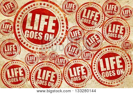 life goes on, red stamp on a grunge paper texture