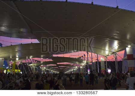 MILAN, ITALY - JUNE 29 2015: People at night at Universal exhibition held in Italy from May to October 2015 Expo on the theme of food