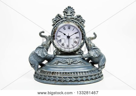 An elephant clock against a white background