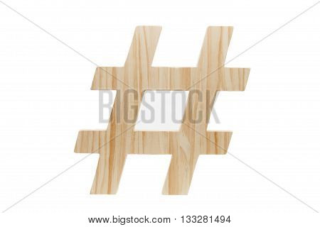 A wood hashtag decoration against a white background