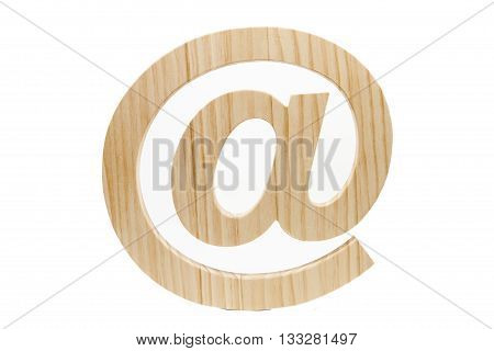 A wood at-sign against a white background