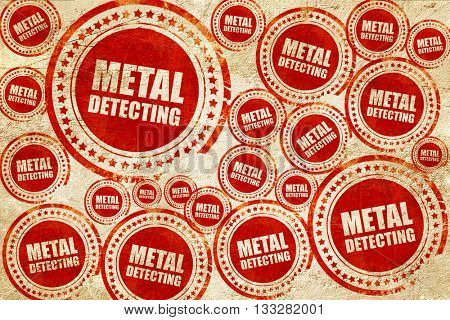 metal detecting, red stamp on a grunge paper texture