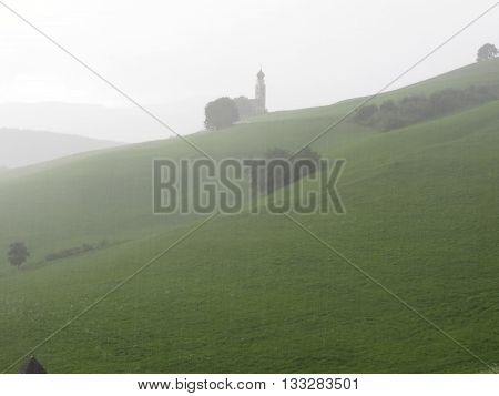 Panoramic view of San Valentino church in a rainy day in Castelrotto South Tyrol - Italy