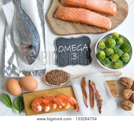 Collection of foods high in fatty acids omega 3 including seafood vegetables and seeds