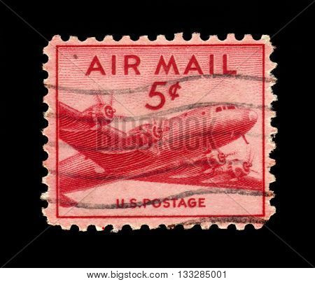 USA - CIRCA 1947: a stamp printed in USA shows Douglas DC-4 Skymaster, four-engine propeller driven airliner developed by the Douglas Aircraft Company, circa 1947
