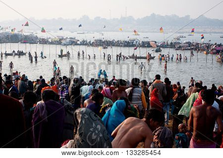SANGAM, INDIA - JANUARY 27, 2013: Thousands of pilgrims bathing in the confluence of the Ganges and the Yamuna during the biggest festival on Earth Kumbh Mela on January 27, 2013 in India.