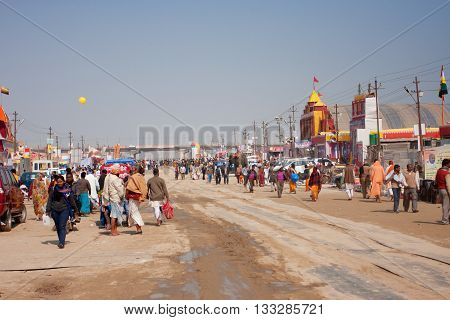 SANGAM, INDIA - JANUARY 27, 2013: People traffic on the road of camp near the confluence of the Ganges and the Yamuna during the biggest festival on Earth Kumbh Mela on January 27, 2013 in Allahabad