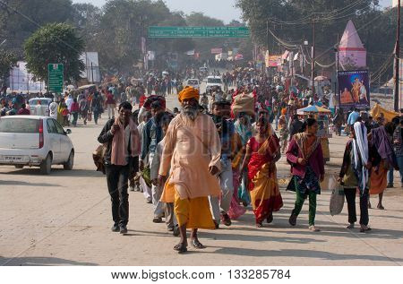 ALLAHABAD, INDIA - JAN 27, 2013: Crowd of the hindu people rush to Sangam during the biggest festival in the world - Kumbh Mela on January 27, 2013 in India. Mela 2013 will take 130 000000 visitors