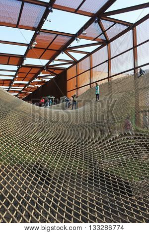 MILAN, ITALY - OCTOBER 12 2015: Brazilian pavilion at Expo 2015 universal exhibition in Milan with people on the suspended net