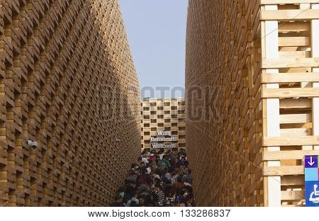 MILAN, ITALY - JUNE 12 2015: Poland Pavilion at Expo 2015 made of wooden crates with people queuing on October 12 2015