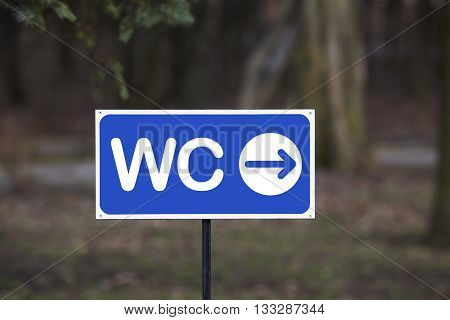 the signpost toilet on a blurred background