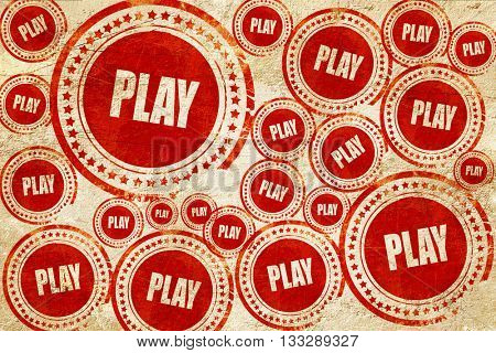 play, red stamp on a grunge paper texture