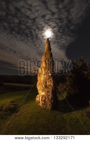 Full moon over Itaida menhir iluminated with a torche