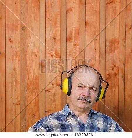 Elderly Man In A Protective Building Headphones