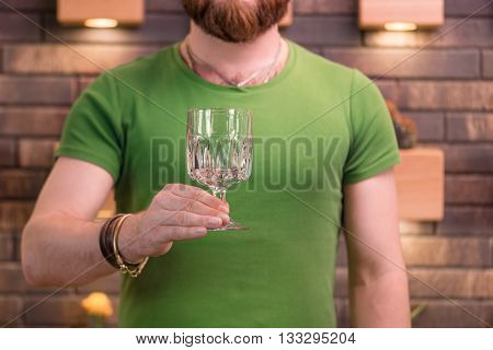 Man with beard holding coctail glass close up