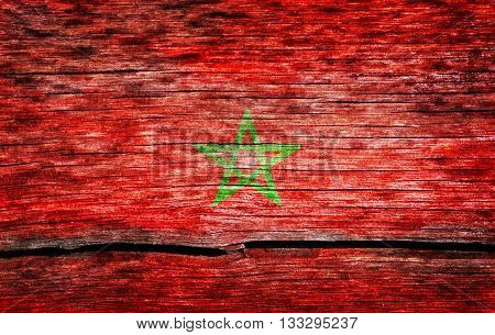Morocco flag painted on the old cracked wood with worn-out paint. Grunge look.