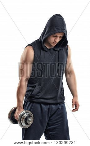 Cut-out athletic young guy in hoodie lifting a dumbbell bulging biceps. Biceps Exercises. Self-perfection. Self improvement. Power training. Healthy lifestyle. Fitness and sport.