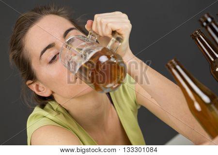 woman drinking beer at bar or pub