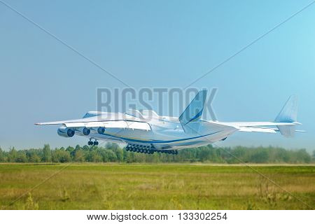 Huge cargo plane taking off, blue sky