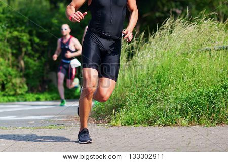 unrecognizable male runner at a foot race