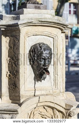Old Water Fountain With Greek Roman Face At Faucet