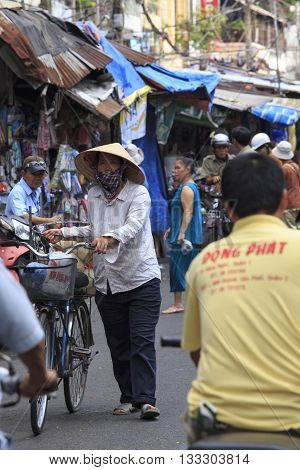 Crowded Marketplace With Street Vendor In Ho Chi Minh City